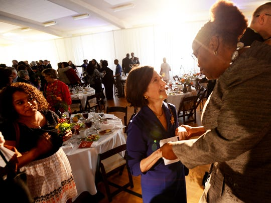 Honoree Paula Hickman congratulates Sandra Ratliff Lee on winning the Virginia K. Shehee Most Influential Woman award.