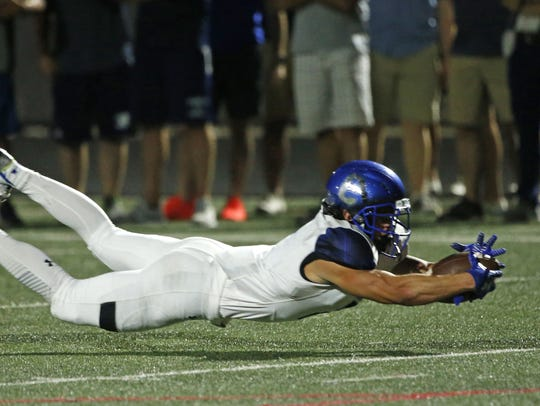 Pinnacle's Tucker Parrish (18) tackles Chandler's Drake