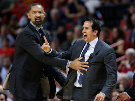 Miami Heat assistant coach Juwan Howard, left, holds back coach Erik Spoelstra as he yells at an official during the second half of the team's NBA basketball game against the Brooklyn Nets, Friday, Dec. 29, 2017, in Miami. The Nets won 111-87. (AP Photo/Lynne Sladky)