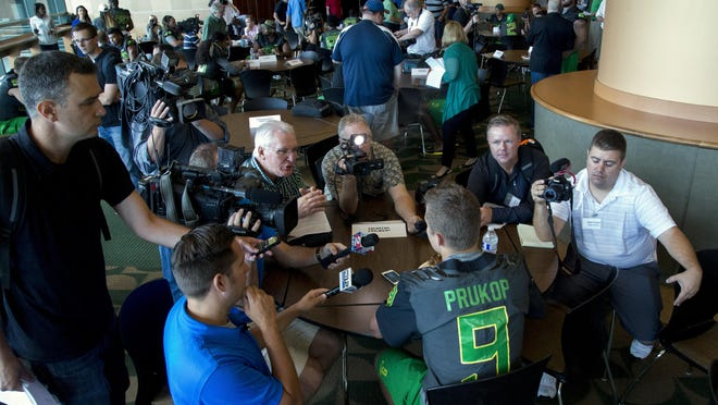 Oregon quarterback Dakota Prukop answers questions from members of the media during Oregon NCAA football media day at Autzen Stadium in Eugene, Ore., Monday, Aug. 8, 2016. Prukop, a graduate transfer from Montana State, is competing for the starting job at quarterback. (Andy Nelson/The Register-Guard via AP)