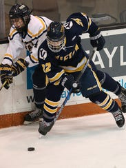 Victor's Sam Lambert controls the puck in front of