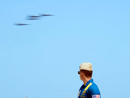 Narrator Capt. Jeff Kuss watches as the Blue Angels
