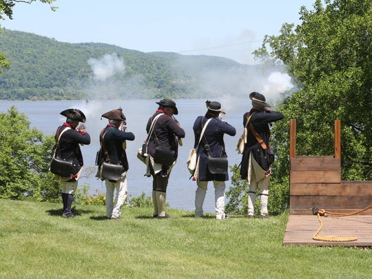 The men from the 2nd New York Provincial Battalion in firing formation, shoot off their muskets during a Revolutionary War re-enactment program at the Stony Point Battlefield Historic Site, May 23, 2015. The event included the re-enacting group, the 2nd New York Provincial Battalion and the sites historic interpreters.