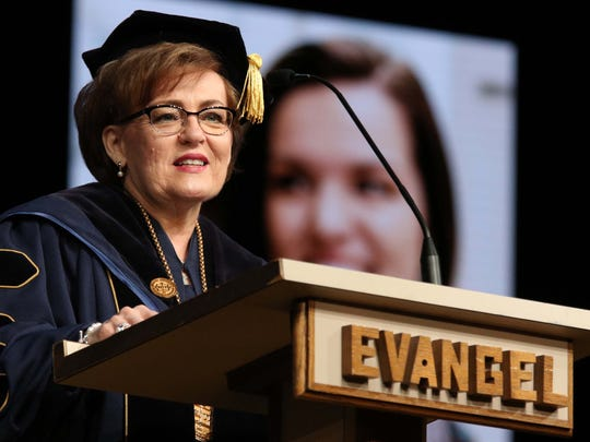 Evangel president Carol Taylor speaks during commencement at James River Church in Ozark on May 6, 2016.