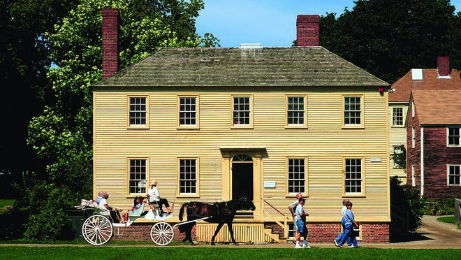 A carriage goes by the Lowd House at Strawbery Banke in Portsmouth. The museum announced it was temporarily closing on July 29 because a staff member has been exposed to a person who tested positive for COVID-19.