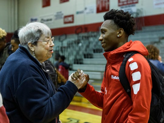 "Sandra ""Sam"" Hunter, a Bosse High School superfan, congratulates Mekhi Lairy (2) on breaking the school's career scoring record during their 85-59 win over the Memorial Tigers, Tuesday, Dec. 12, 2017.  Lairy is now the all-time leading scorer in school history with 1,560 points, passing 1967 graduate Larry Weatherford's record of 1,559 points."