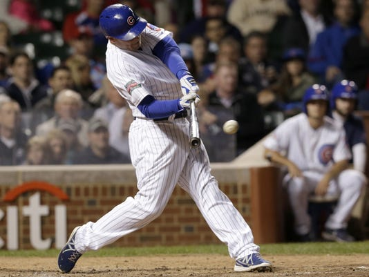 Chicago Cubs' Chris Valaika hits an RBI single off St. Louis Cardinals relief pitcher Carlos Martinez, scoring Ryan Kalish, during the eighth inning of a baseball game Wednesday, Sept. 24, 2014, in Chicago. (AP Photo/Charles Rex Arbogast)