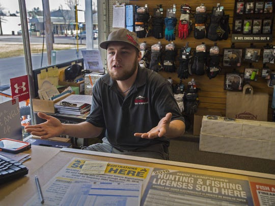 Dylan Holcomb of Manchester, New Hampshire, who works at Benson Ski & Sport in Derry, said he has not decided which primary he will vote in in the upcoming presidential primary. Seen on Thursday, February 4, 2016.