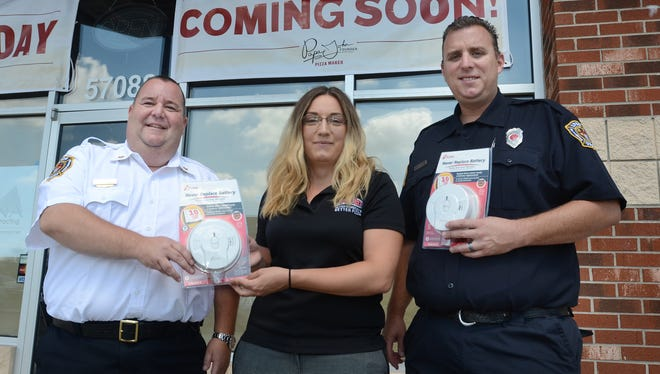 The Lyon Township Fire Department will team up with the new Papa John's Pizza  on Ten Mile Road to promote home fire safety as it checks on homeowners' smoke detectors as they accept delivery of their pizzas. Fire personnel will check on the home's detectors to make sure they're working and give out new detectors to those without. Pictured here are Lyon Township's Fire Marshal Don Collick, at left, its Fire Inspector Brian Holzheimer, and Lyon Township's Papa John's owner Alaura Harper.