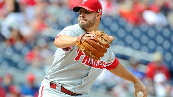 Philadelphia Phillies starting pitcher Adam Morgan  throws to the Washington Nationals during the third inning at Nationals Park on Sunday.
