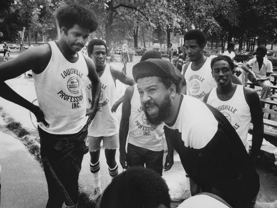 Coach John Patrick of the Old Timers gave his team some advice during their Dirt Bowl game on Aug. 22, 1976.