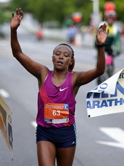 Margaret Maina celebrates her first-place finish in the 500 Festival OneAmerican Mini-Marathon on May 6, 2017,  in Indianapolis. Maina finished in 1:15:51.