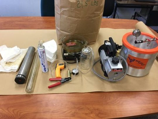 Authorities uncovered a butane honey oil lab, marijuana, heroin and more in a Monterey home.