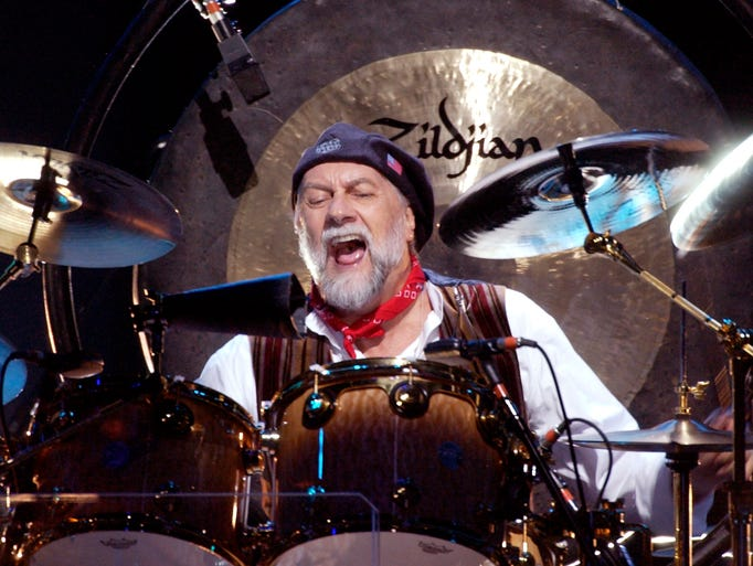 Mick Fleetwood, drummer for Fleetwood Mac, entertains a Conseco Fieldhouse crowd June 24, 2003, during their concert.