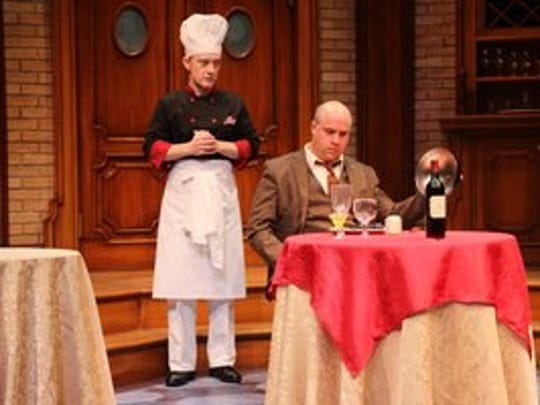 "Chef Gaston (Andrew Sellon) talks with the suicidal Victor (Jim VanValen) in Riverside Theatre's production of ""An Empty Plate in the Café du Grand Boeuf."""