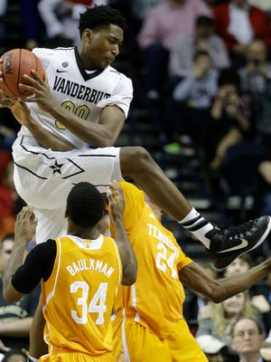 FILE -- In this March 12, 2015 file photo, Vanderbilt center Damian Jones (30) pulls in a rebound over Tennessee guard Devon Baulkman (34) and forward Willie Carmichael III (24) in an NCAA college basketball game in  the Southeastern Conference tournament in Nashville, Tenn. Jones has decided earlier this year that he will enter the NBA draft after his junior season. (AP Photo/Mark Humphrey)