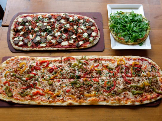 (bottom) An extra large sausage and peppers pizza,