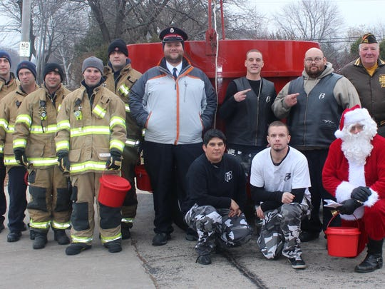 "The 2014 Bucket Brigade, hosted by KFIZ and K107.1 and Michels Corporation, raised a record $15,187.64 to help the Red Kettle Campaign. Bucket Brigade members from the Fond du Lac Firefighters Local 400, the Ruff Ryders, VFW Post 1904 Bohlman-Grimes Post and Ed ""Santa"" Barnes collected donations outside the radio station. Michels Corporation matched collected bucket donations. ""Teamwork is one of Michels core values. One of the countless ways we bring that to life is by partnering with important organizations like The Salvation Army. We are honored to support efforts to make our community a better place to live and work,"" said Pat Michels, Michels Corporation president."