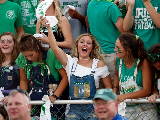 Students cheer at a Springfield Catholic football game last year.