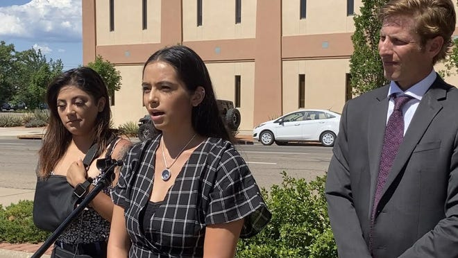 Jaelyn Cedillo, center, speaks in front of the Pueblo district attorney's office Thursday along side Briseida Gaucin, left, and Sean Simeson, an attorney with Baumgartner Law in Denver who is representing the Cedillo family.
