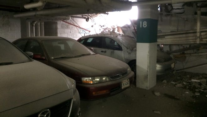Parked cars are seen near a part of collapsed structure at the Watergate complex in Washington,  on Friday, May 1, 2015. District of Columbia rescuers were responding to a structural collapse in the garage at the Watergate complex.