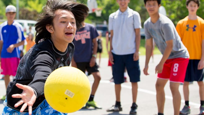 The annual alumni kickball game at Belle Sherman Elementary School