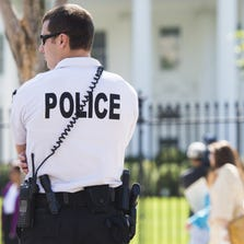 A member of the US Secret Service Uniformed Division patrols outside the White House in Washington, DC, September 22, 2014. Secret Service has increased their security presence around the White House perimiter following a string of incidents, including one late this past Friday where an intruder ran across the North Lawn and entered the main residence before being subdued by an officer.