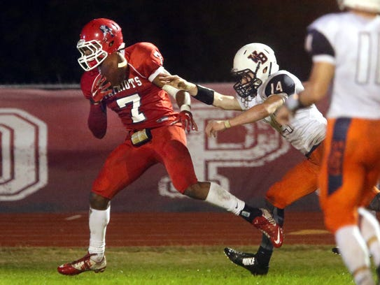 Oakland's JaCoby Stevens (7) runs the ball in for a