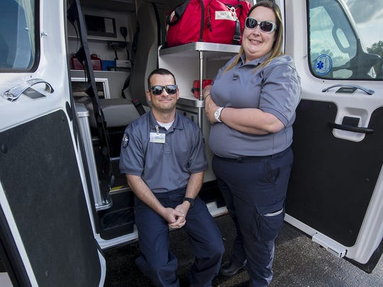 Jason Tibbetts and Katie Warrick, both emergency medical technicians with Midwest Ambulance, were traveling behind a semitrailer truck that crashed, erupting into a fireball, on Friday, May 15, 2014, along I-465 on Indianapolis' Northeastside. The quick-thinking pair pulled the driver William J. Hosier, 52, and his ex-wife, Cynthia Hosier, 58, both from Wabash, from the burning wreckage.
