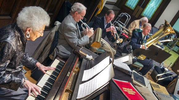 Mary Jane Campanella, left, has been playing with the orchestra for 76 years. Paul Kuehnel - Daily Record/Sunday News