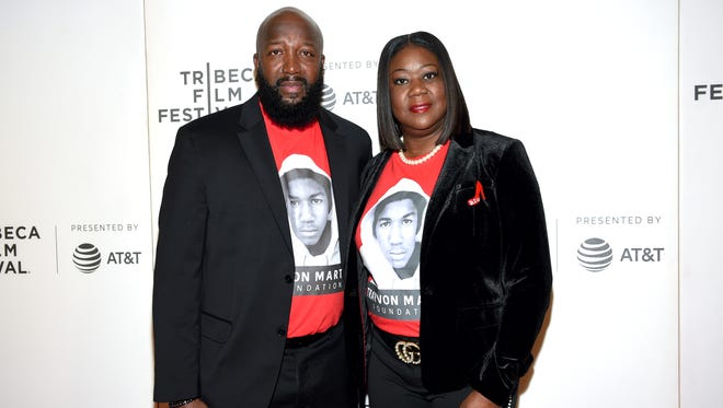 "In this Friday, April 20, 2018, file photo, Trayvon Martin's parents, Tracy Martin, left, and Sybrina Fulton, attend the Tribeca TV screening of ""Rest in Power: The Trayvon Martin Story"" at BMCC Tribeca PAC, during the 2018 Tribeca Film Festival in New York. Martin and Fulton say The Weinstein Company owes them at least $150,000 for optioning the rights to their book in order to make a yet unaired television series based on their son's legacy."