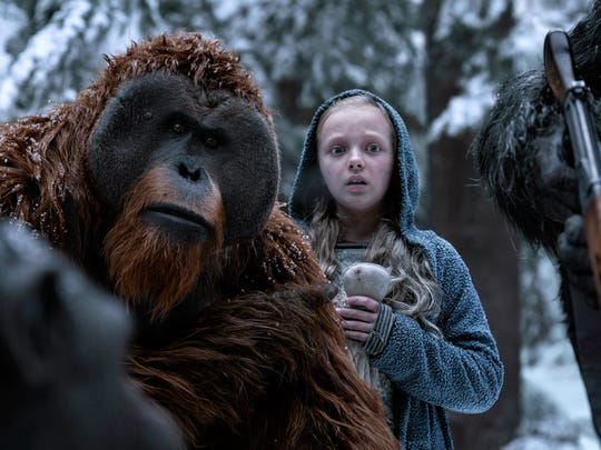"This image released by Twentieth Century Fox shows Karin Konoval, left, and Amiah Miller in ""War for the Planet of the Apes."""