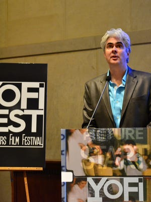 YoFi Fest Creative Director Dave Steck gives a welcome speech at the 2014 opening night.