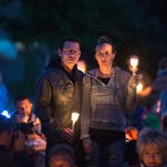 People attend a prayer service and candlelight vigil  in Winston, Ore., on Oct. 3, 2015, to remember the victims of the mass shooting at Umpqua Community College.