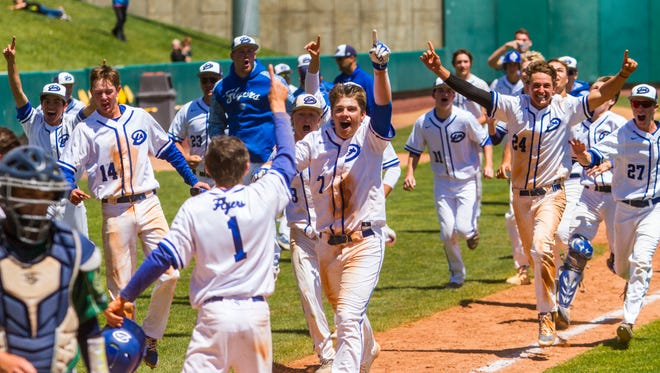 Dixie's Cooper Vest (7) celebrates with his teammates after hitting a walk-off home run to win the 3A state championship, Saturday, May 20, 2017.