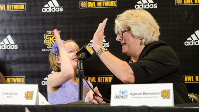 Kennesaw State women's basketball coach Agnus Berenato and 8-year-old Cate Zavitz share a high five last season.