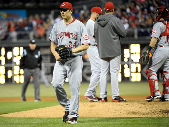 Cincinnati Reds starting pitcher Homer Bailey (34) walks to the dugout after being pulled from the game.
