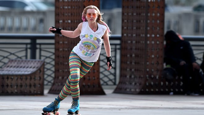 Shelby Hedmen enjoys the 63 degree weather as she skates on the Reno Art Plaza in downtown Reno on  Feb. 1, 2018.