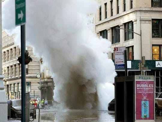 Steam billows on New York's Fifth Avenue, Thursday,