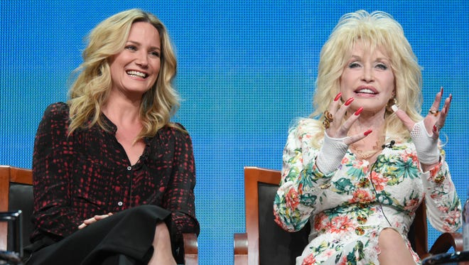"Jennifer Nettles, left, and Dolly Parton speak at the ""Dolly Parton's Coat of Many Colors"" panel at the NBCUniversal Television Critics Association Summer Tour on Aug. 13 at the Beverly Hilton Hotel in Beverly Hills, Calif."