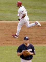 The Cardinals' Albert Pujols runs the bases after hitting