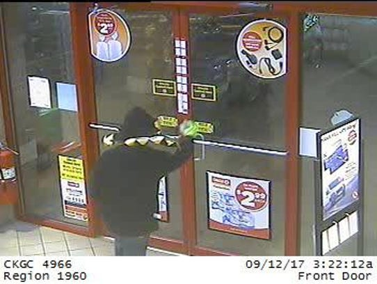 Surveillance footage shows a suspect walking in to