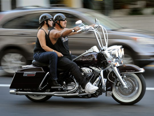 Bikers ride through downtown Reno during a previous