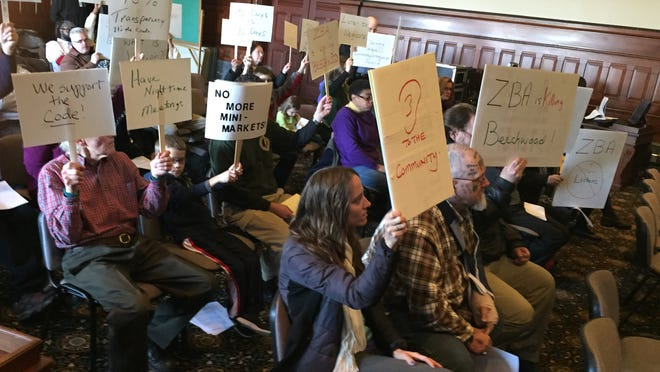 Beechwood residents protest the city's handling of corner stores at a zoning board meeting Thursday.