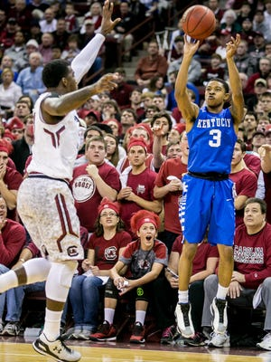 Jan 24, 2015; Columbia, SC, USA; Kentucky Wildcats guard Tyler Ulis (3) attempts a three pointer over South Carolina Gamecocks guard Duane Notice (10) in the first half at Colonial Life Arena. Mandatory Credit: Jeff Blake-USA TODAY Sports