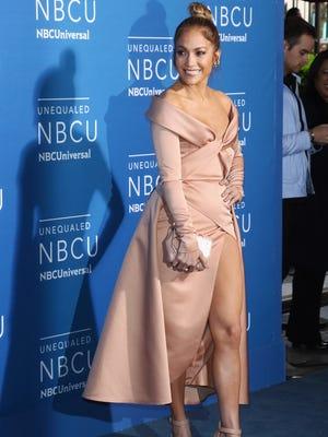 Jennifer Lopez rocked the NBC Upfront blue carpet in a beige satin gown.