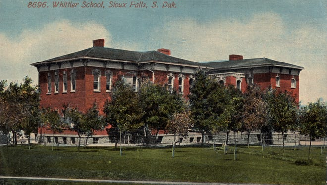 This postcard shows the first Whittier school in the early 1900s.