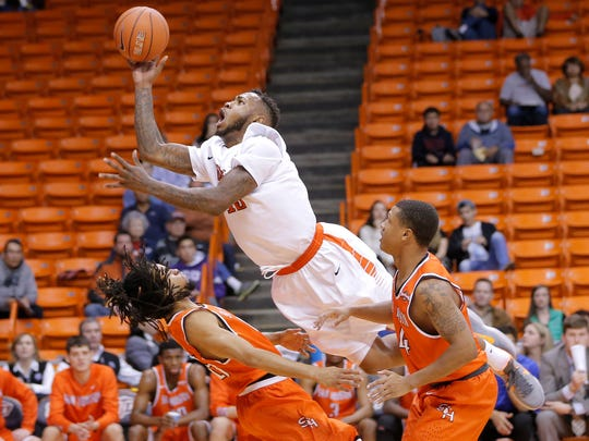 UTEP's Terry Winn collides with Sam Houston guard Josh Delaney during their game Tuesday in the WestStar Bank Don Haskins Sun Bowl Invitational.