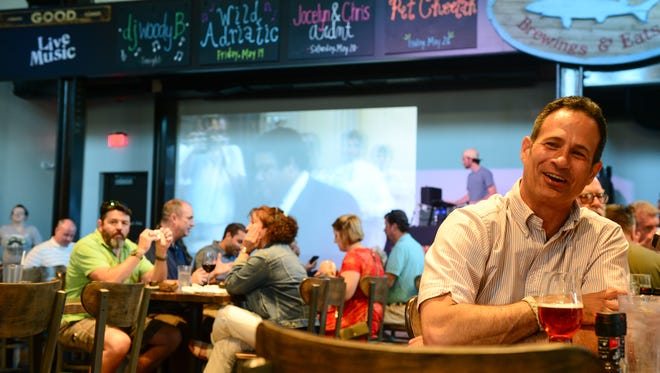 Sam Calagione, founder of Dogfish Head Craft Brewery and a 2017 James Beard Award winner, enjoys a brew at his new restaurant Dogfish Head Brewings & Eats in Rehoboth Beach. The $4 million eatery has replaced the old building on Rehoboth Avenue.