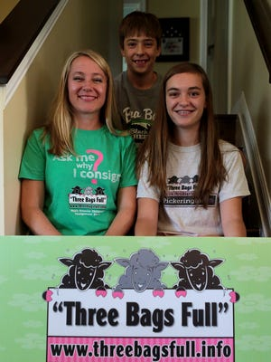 DeAnn Nightingale with her two children Jonathan and Savanna. Nightingale started her consignment shop, Three Bags Full, when her children were one and five to help save money on kids items. The business has since grown, and her two children now help with the sales.